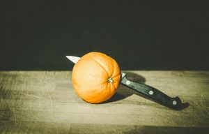 how to be a freelance copywriter UK - sliced orange to represent tax